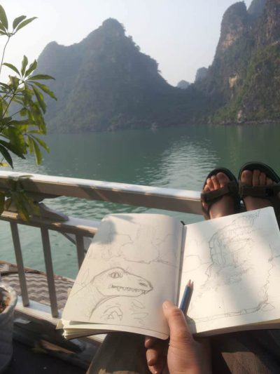 Sketching on a boat in Ha Long Bay, Vietnam.