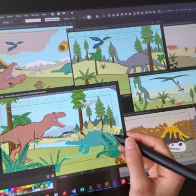 Illustrating dinosaurs for the animation on a Wacom Cintiq drawing tablet.