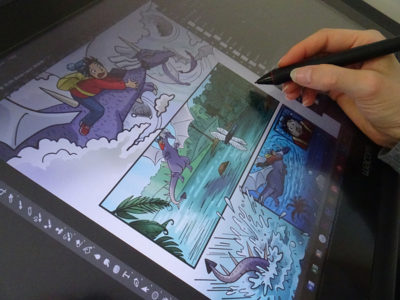 Digitally colouring the comic in Photoshop with a Wacom Cintiq.
