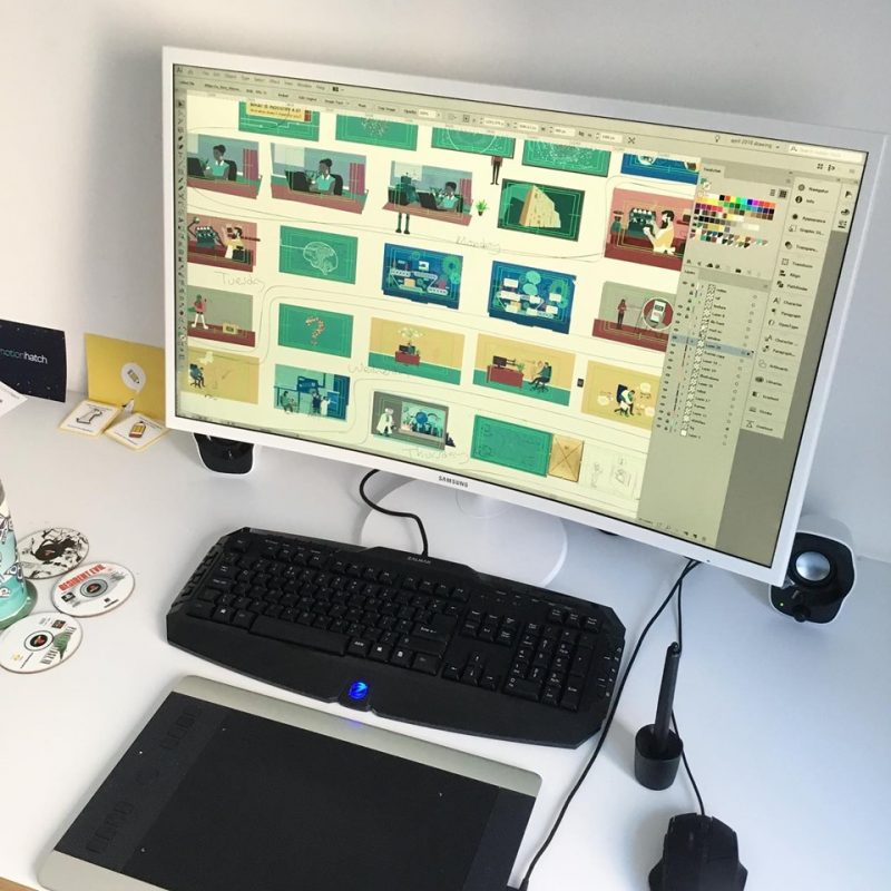 storyboard illustrations on a curved monitor